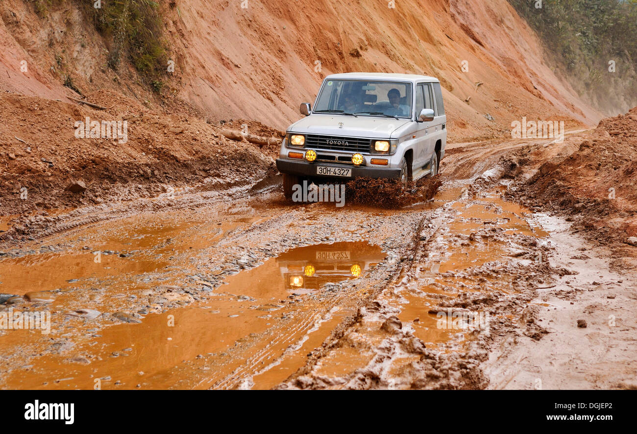 Jeep driving through the Mai Chau Valley, Vietnam, Asia - Stock Image