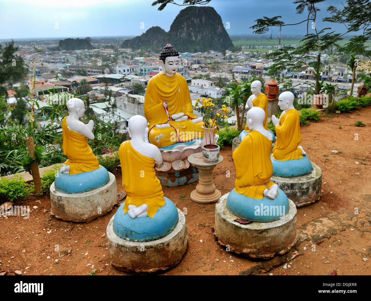 Buddha and praying monks, sculptures in front of Marble Mountains, Ngu Hanh Son, Thuy Son, Da Nang, Vietnam, Asia - Stock Image