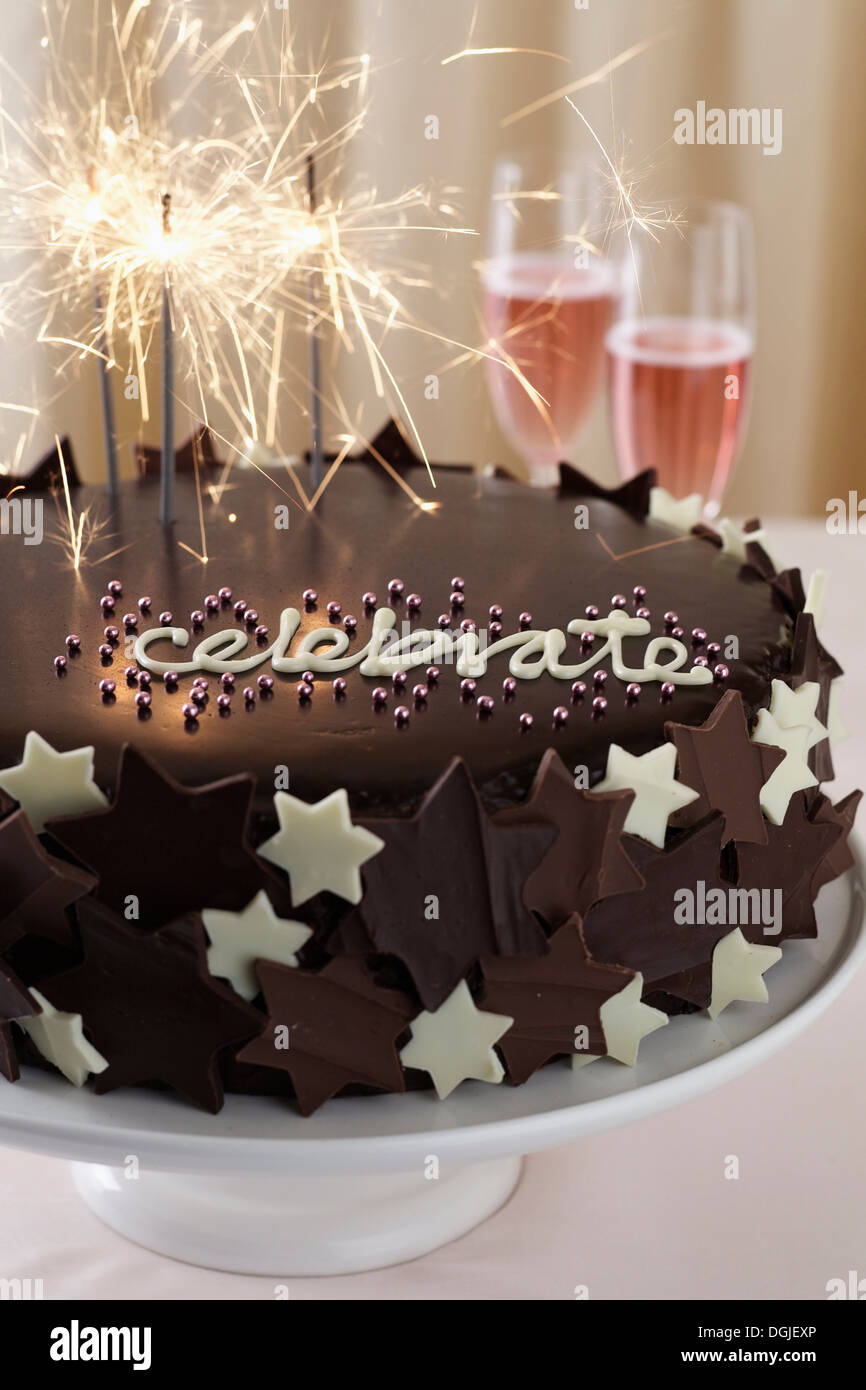 Chocolate Cake With Word Celebrate And Sparklers