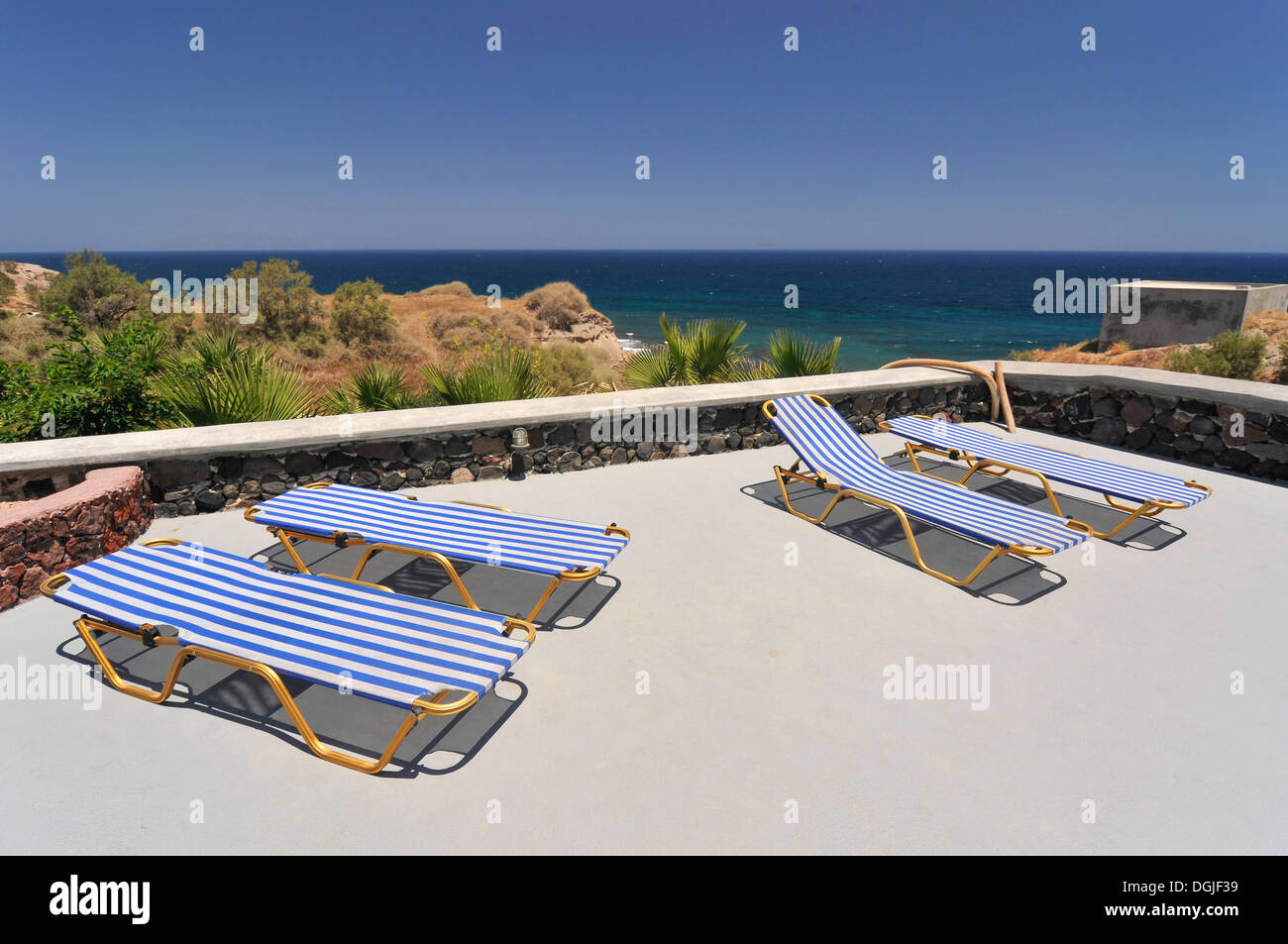 Sun loungers on the terrace of a Greek gueshouse, Santorini, Cyclades, Greece, Europe - Stock Image