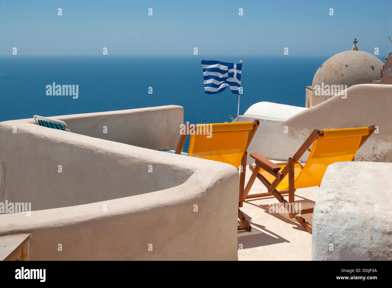 Sun loungers on the terrace of a Greek guesthouse, Santorini, Cyclades, Greece, Europe - Stock Image