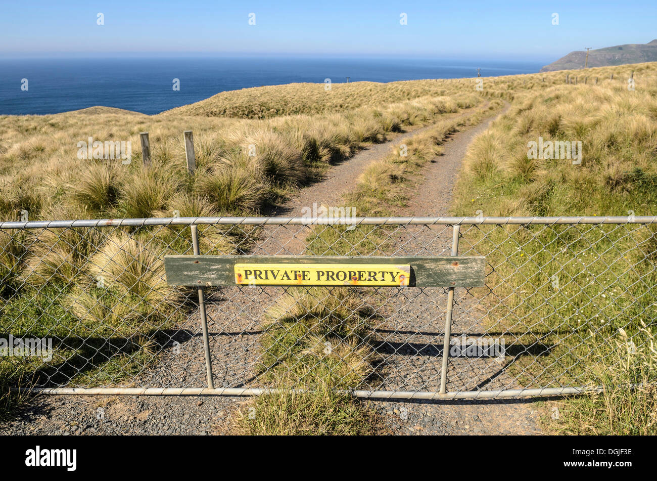 Gate with a sign, Private Property, Otago, South Island, New Zealand, Oceania - Stock Image