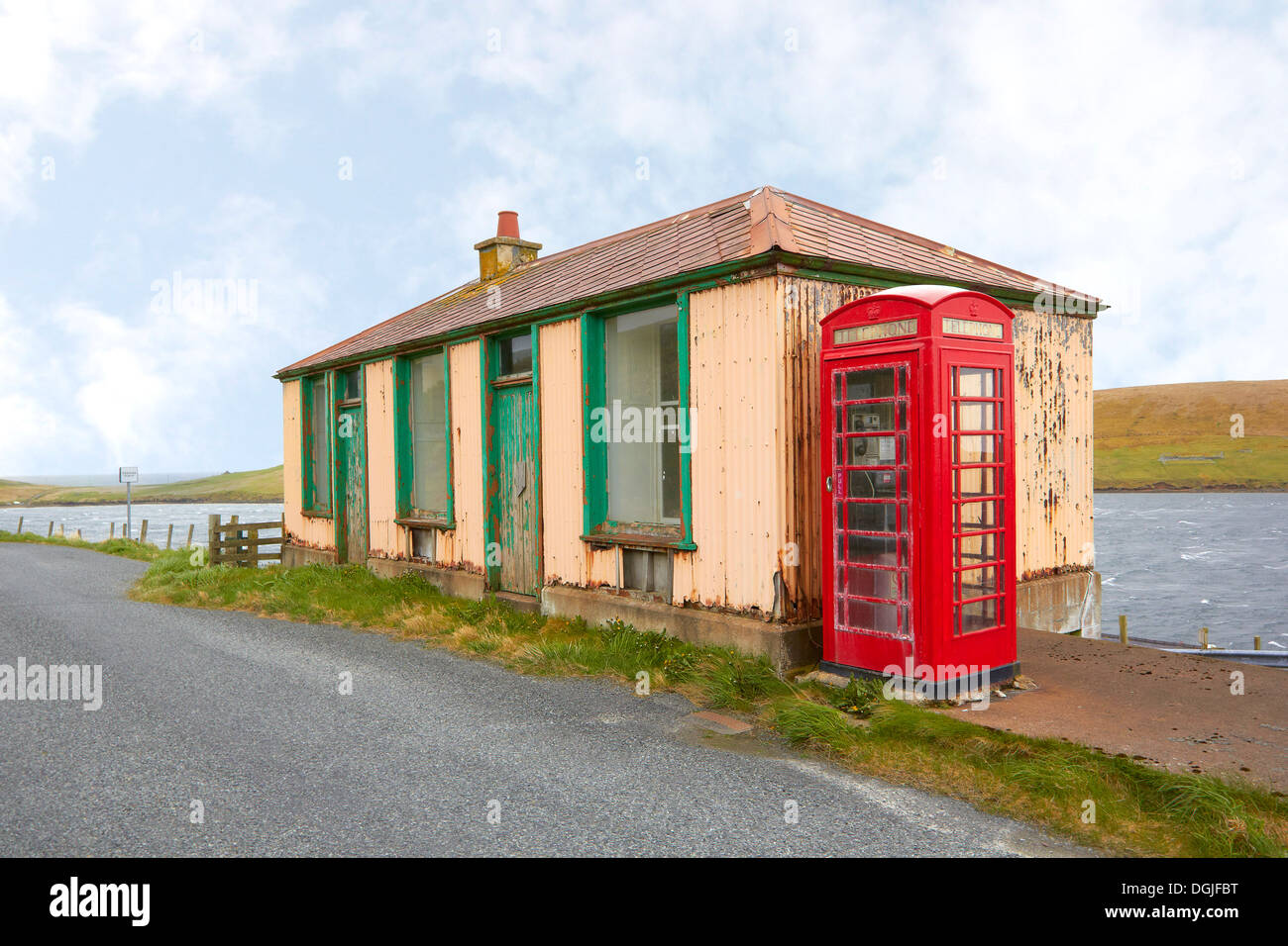 Disused shop with phone box. - Stock Image