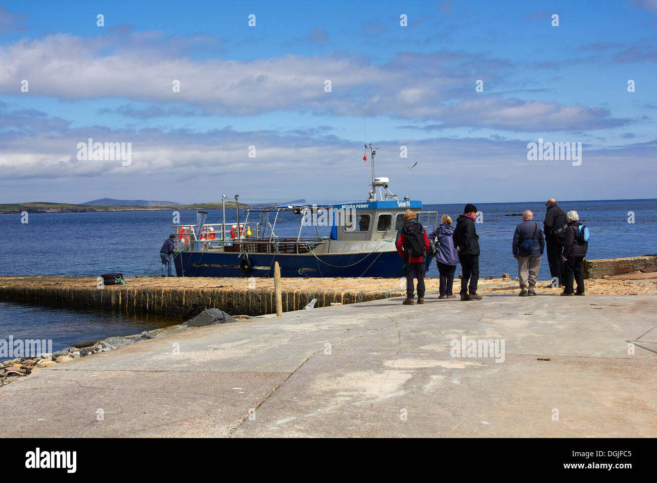 Tourists waiting to board the ferry to the island of Mousa. - Stock Image