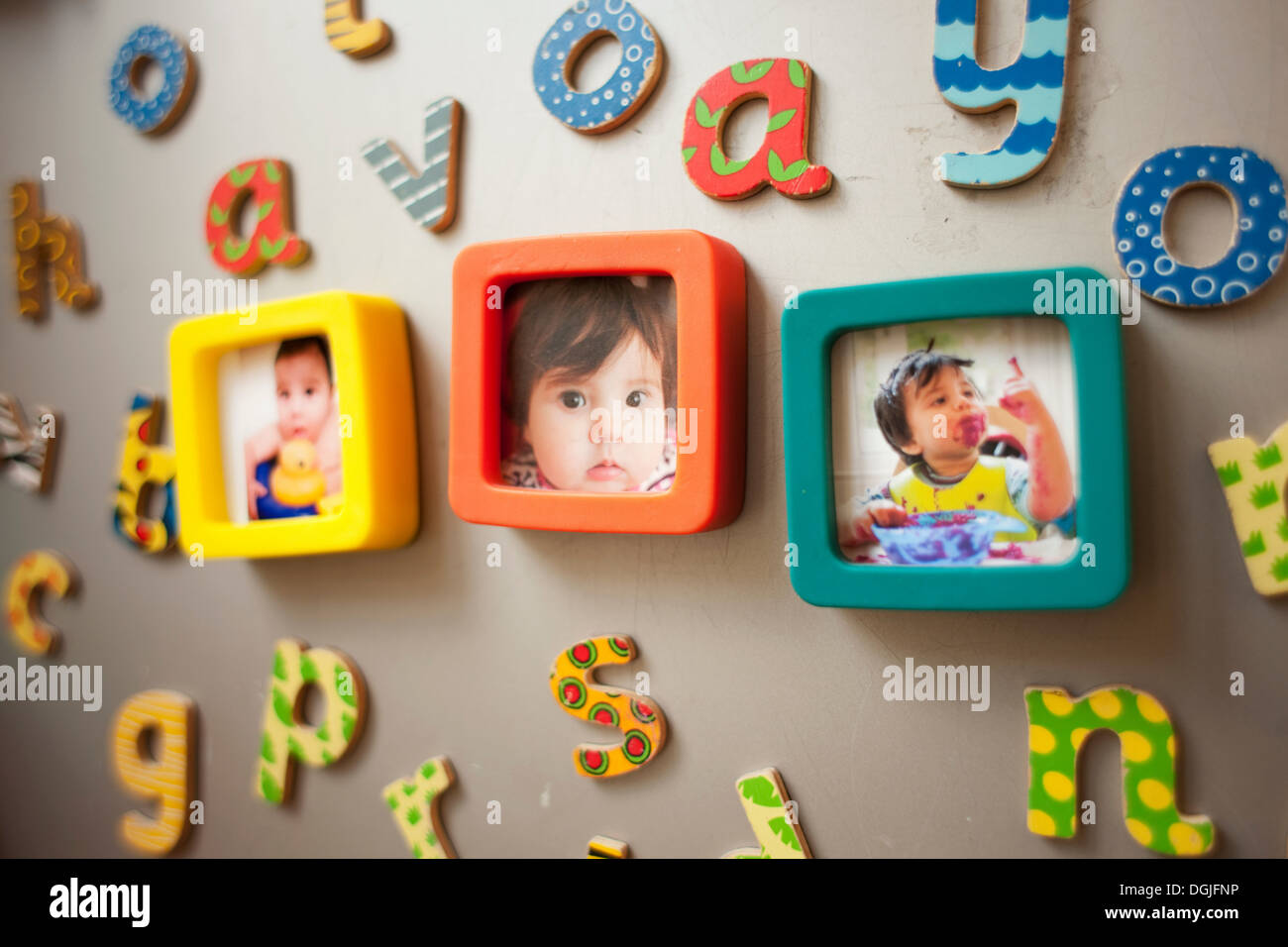 Childhood photographs and picture on wall - Stock Image