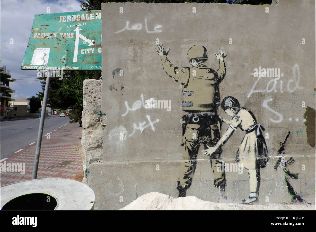 Wall with a graffito by Banksy, Palestinian side, between Bethlehem, West Bank and Jerusalem, Israel, Middle East - Stock Image