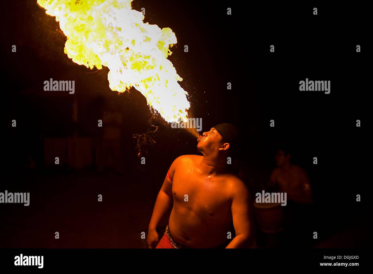 A fire breather performing in Langkawi. - Stock Image