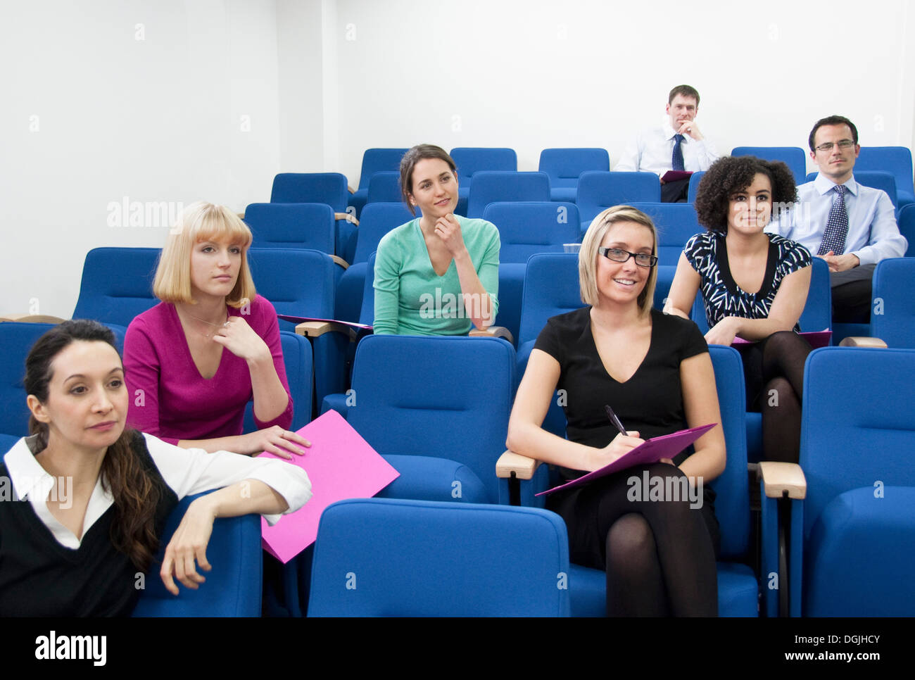 Colleagues sitting for presentation - Stock Image