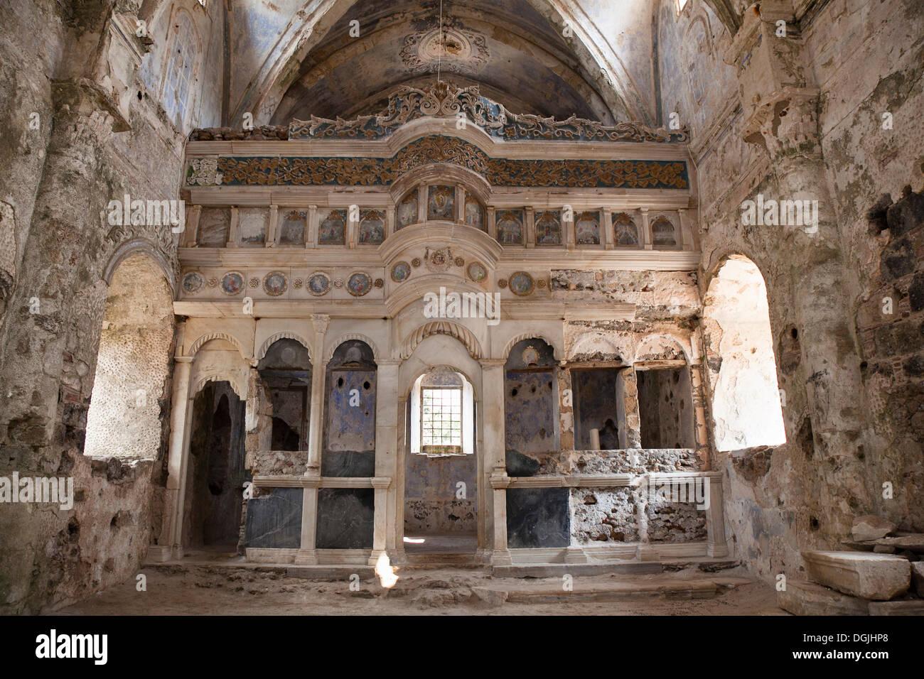 Deserted Greek Orthodox church in the ghost town of Kayakoey near Fethiye, former Levissi, Lycia, Mediterranean, Turkey - Stock Image