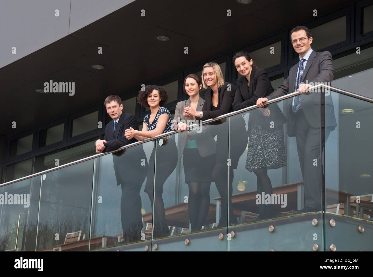 Six office colleagues on balcony - Stock Image