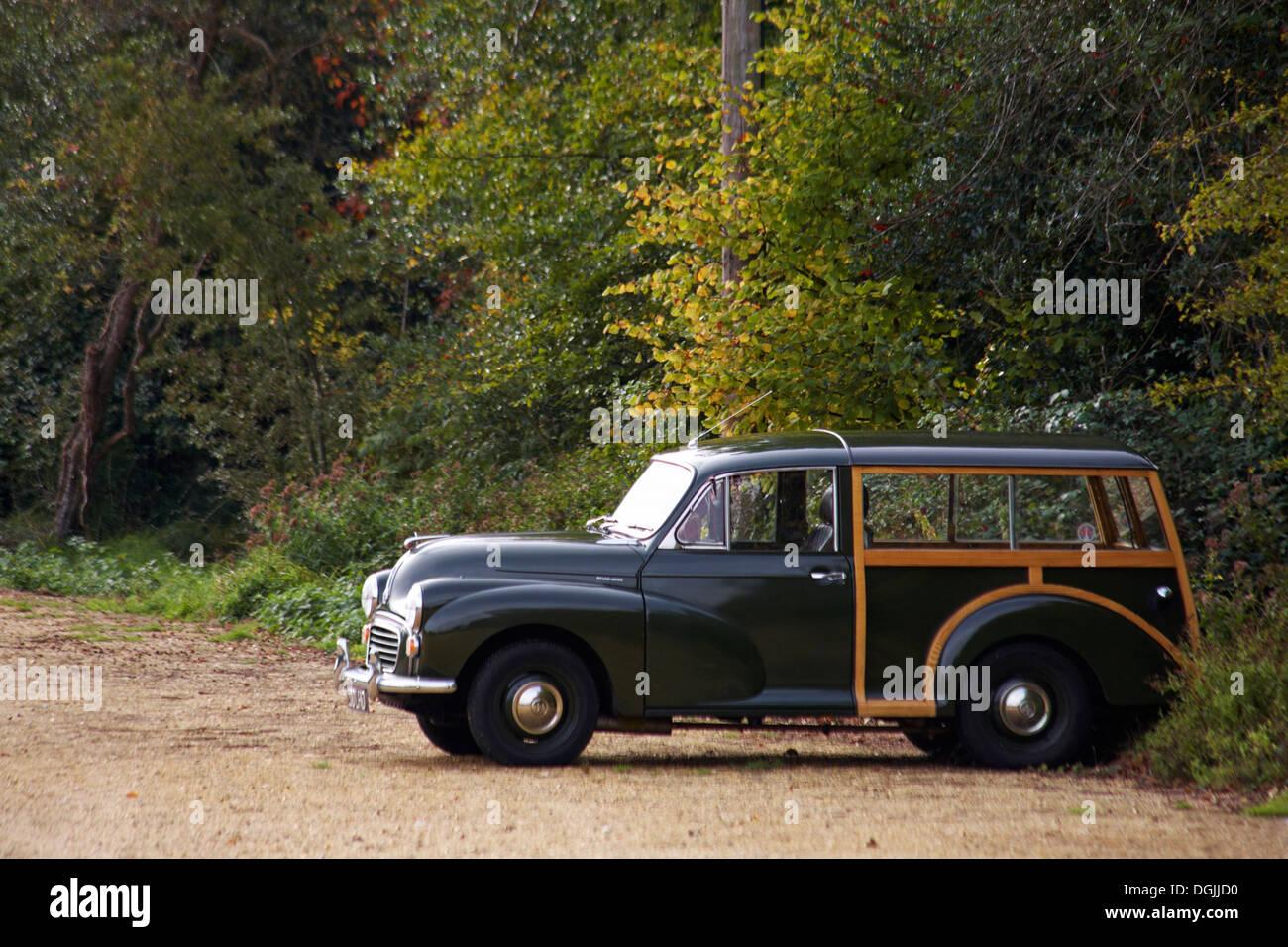 Morris Minor 1000 traveller classic British estate car parked in car park at Buckler's Hard in October - Stock Image
