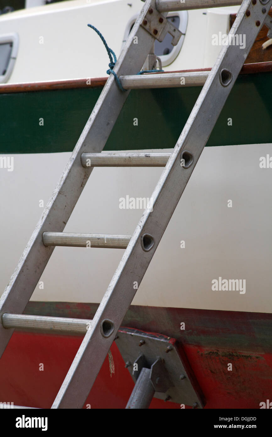 ladders leant against boat - Stock Image