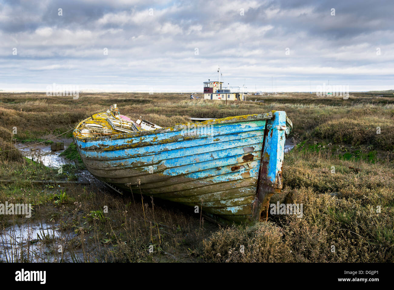 The remains of an old wooden dinghy abandoned in the Tollesbury Saltings. Stock Photo