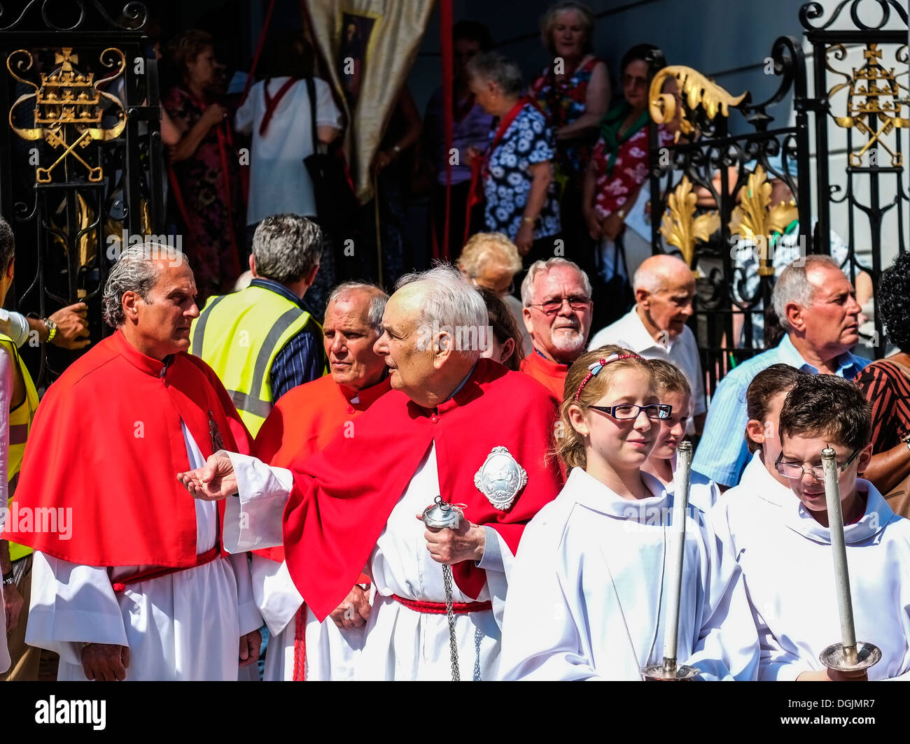 Church officials waiting for the start of the annual Procession in Honour of Our Lady of Mount Carmel. - Stock Image