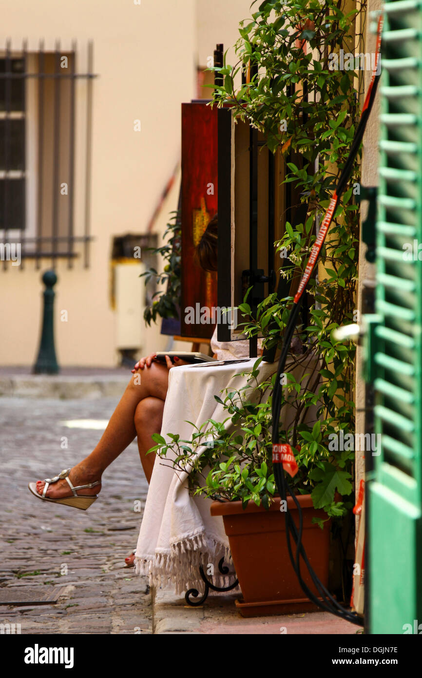 Woman Reading A Book In Front Of A House In An Alley, St. Tropez, Cote Du0027Azur  Or French Riviera, France, Europe