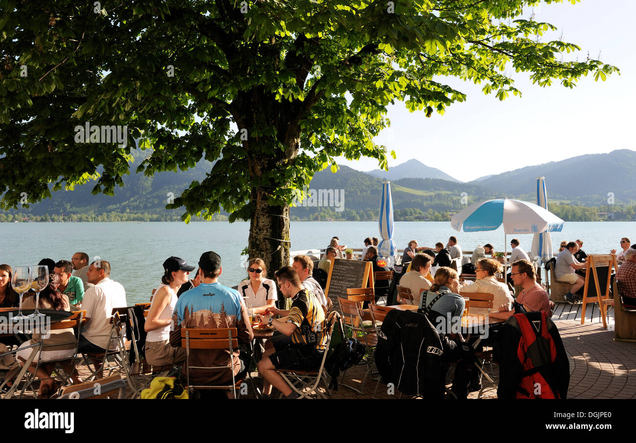 Beer garden on Lake Tegernsee, Upper Bavaria, Bavaria - Stock Image