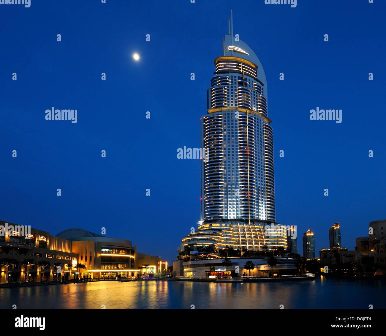 'The Address' luxury hotel, 63 floors, and Dubai Mall at dusk, downtown Dubai, Business Bay, Dubai, United Arab Emirates - Stock Image