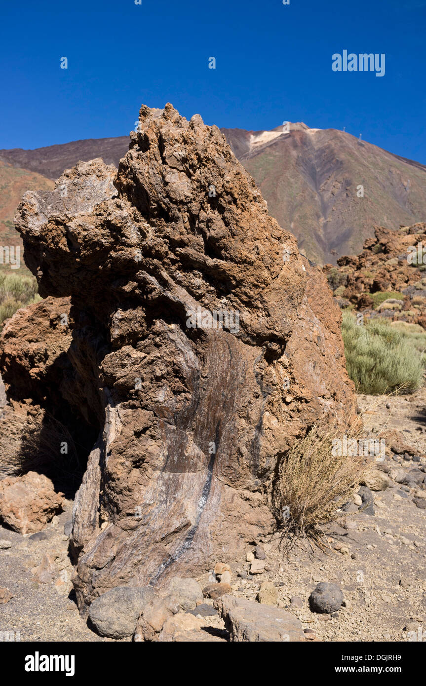 Solidified magma rock formation with strata in front of mount Teide on Tenerife, Canary Islands, Spain - Stock Image
