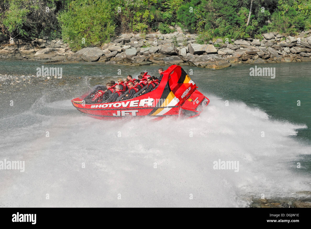 Jetboat, speedboat turning on the Shotover River, Queenstown, South Island, New Zealand - Stock Image
