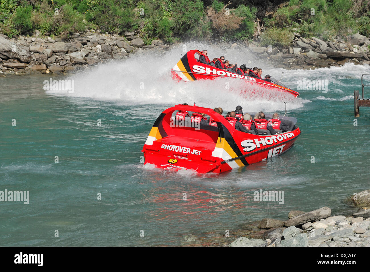 Jet boats, speed boats on the Shotover River, Queenstown, South Island, New Zealand - Stock Image