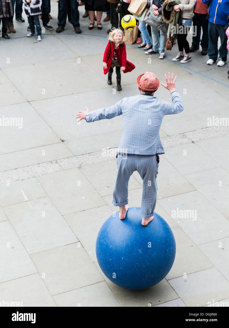 A street performer entertaining people in London. - Stock Image