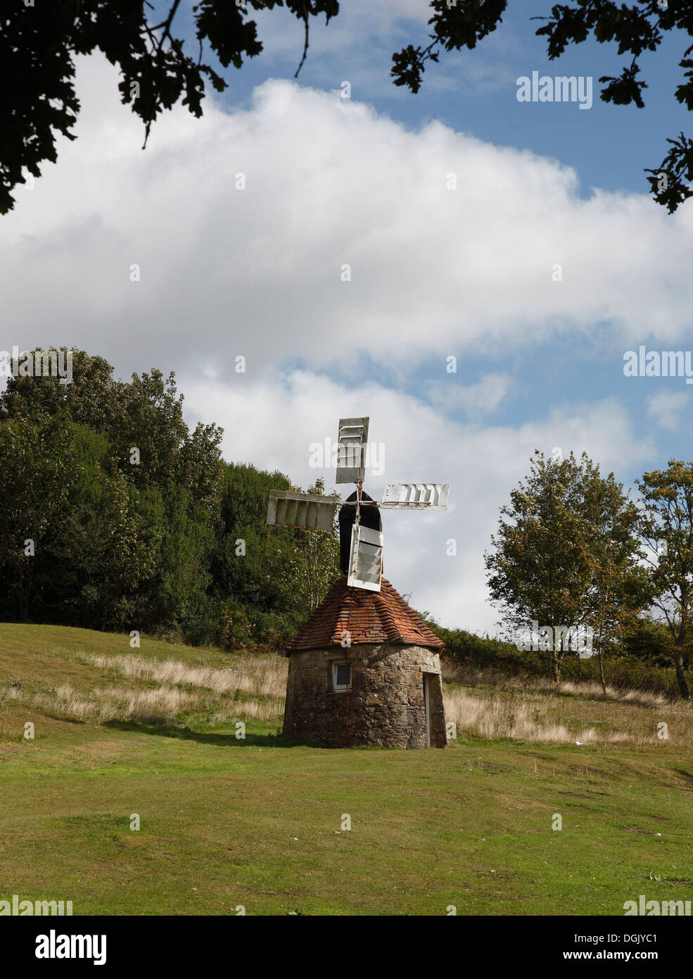 Model windmill on round building Isle of Wight, Hampshire, England - Stock Image