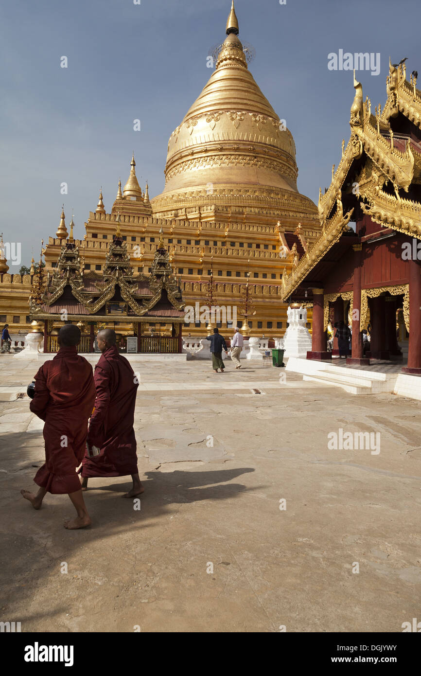 Two monks walking at the Shwezigon Pagoda in Bagan in Myanmar. Stock Photo