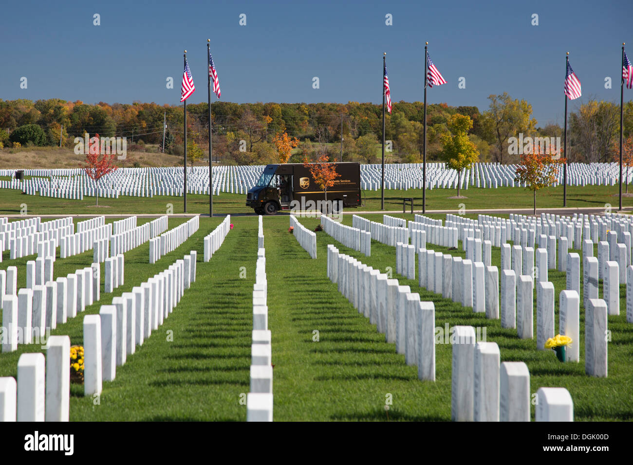 A UPS delivery truck in the Great Lakes National Cemetery. - Stock Image