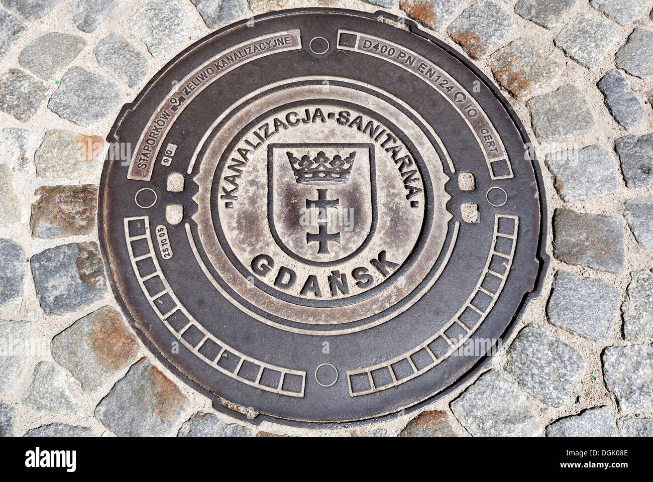Manhole cover at the Long Market Gdansk. - Stock Image