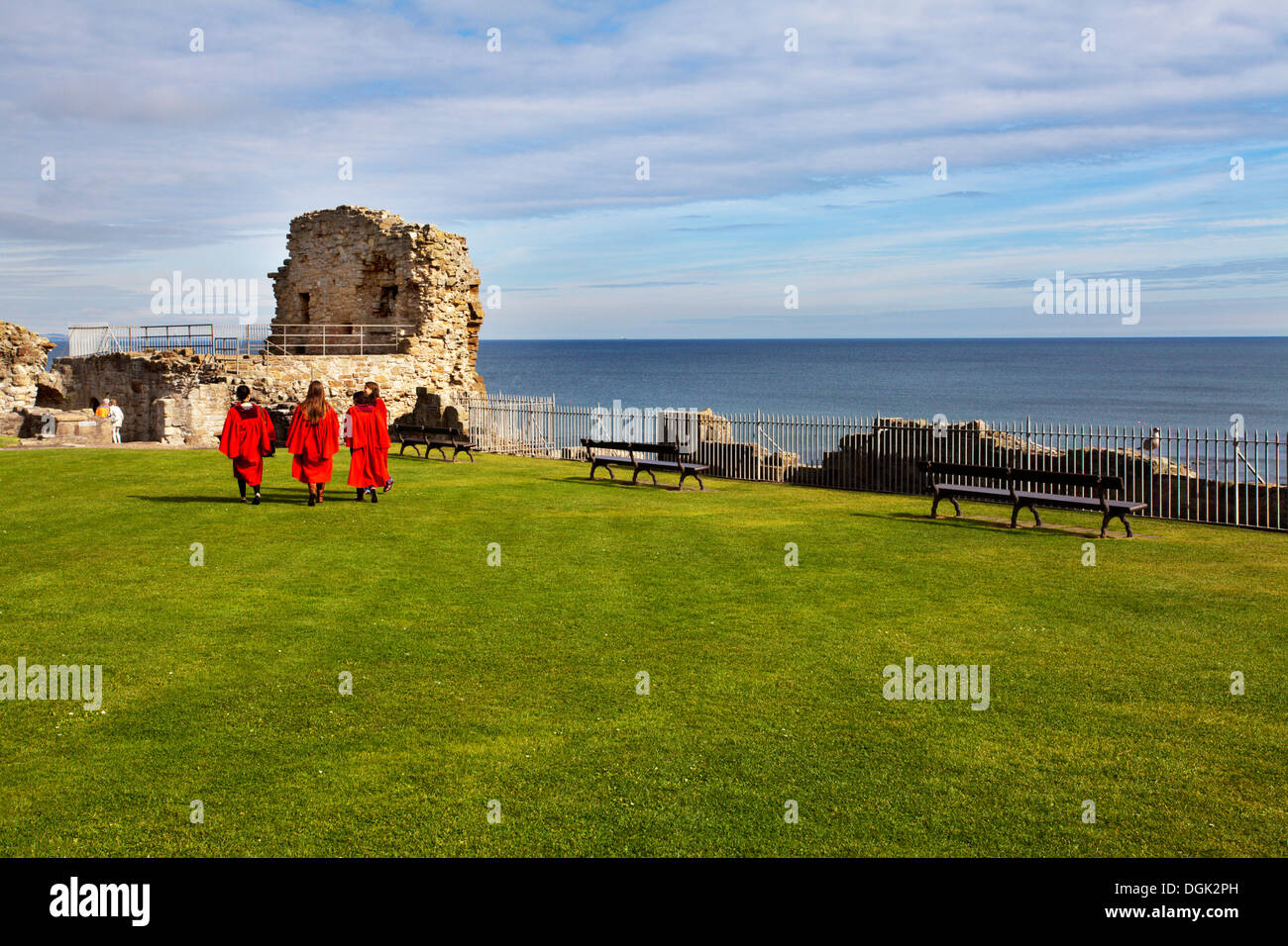St Andrews Castle with University Students in Red Gowns St Andrews Fife Scotland - Stock Image