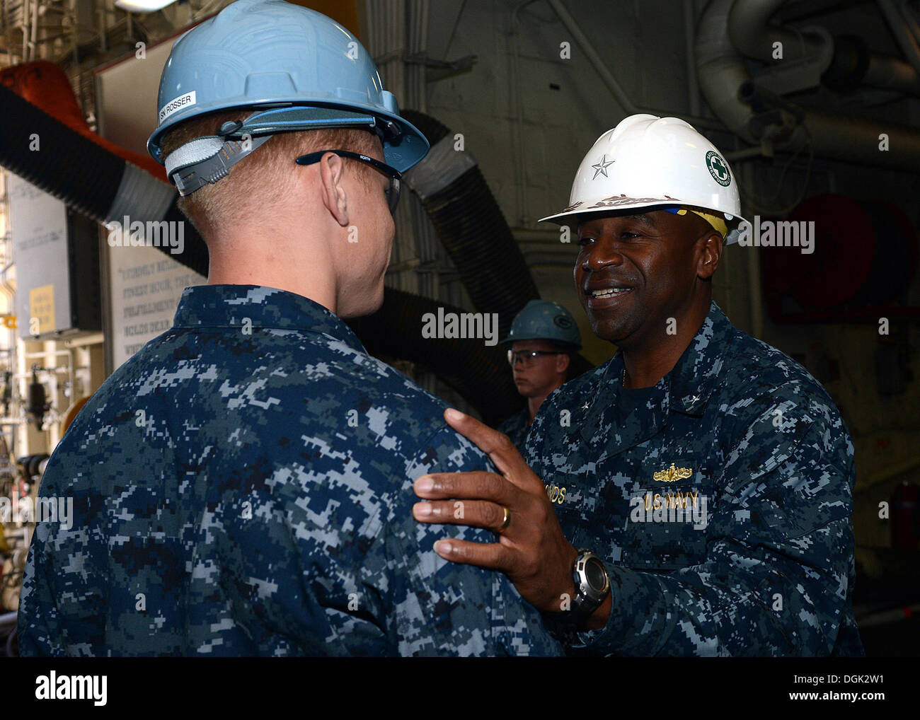 Commander of Expeditionary Strike Group (ESG) 3 Rear Adm. Frank Pond thanks Seaman David Rosser for his service Stock Photo