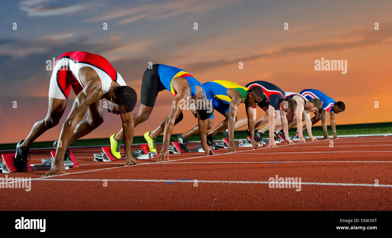 Six athletes starting race - Stock Image