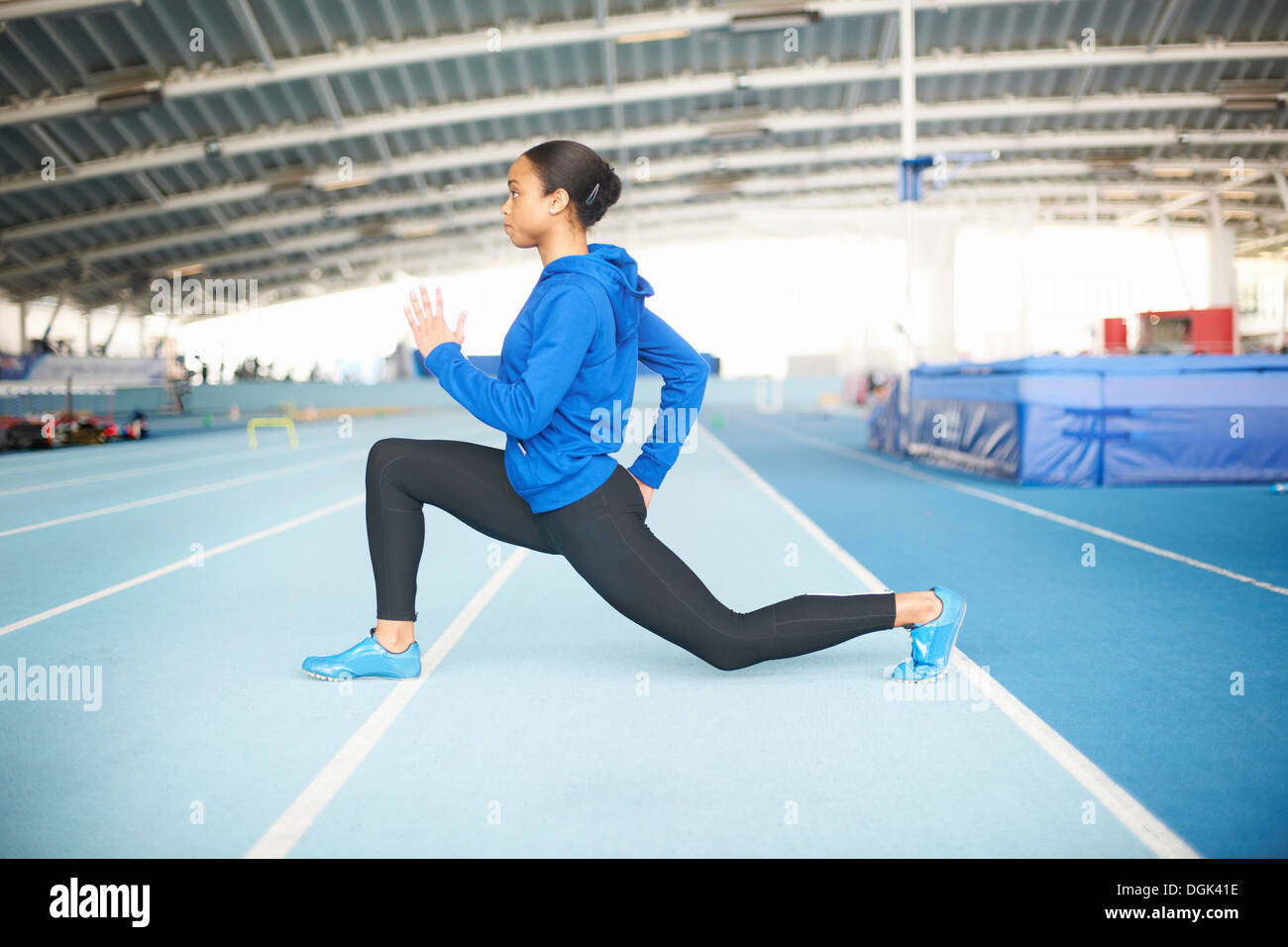 Young female athlete lunging - Stock Image