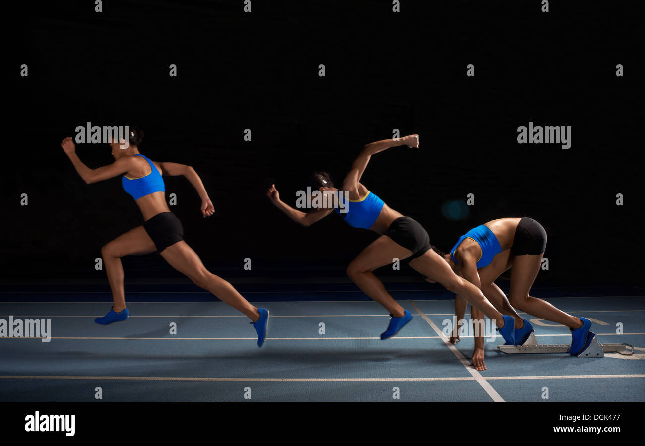 Young female athlete starting race, multiple exposure - Stock Image