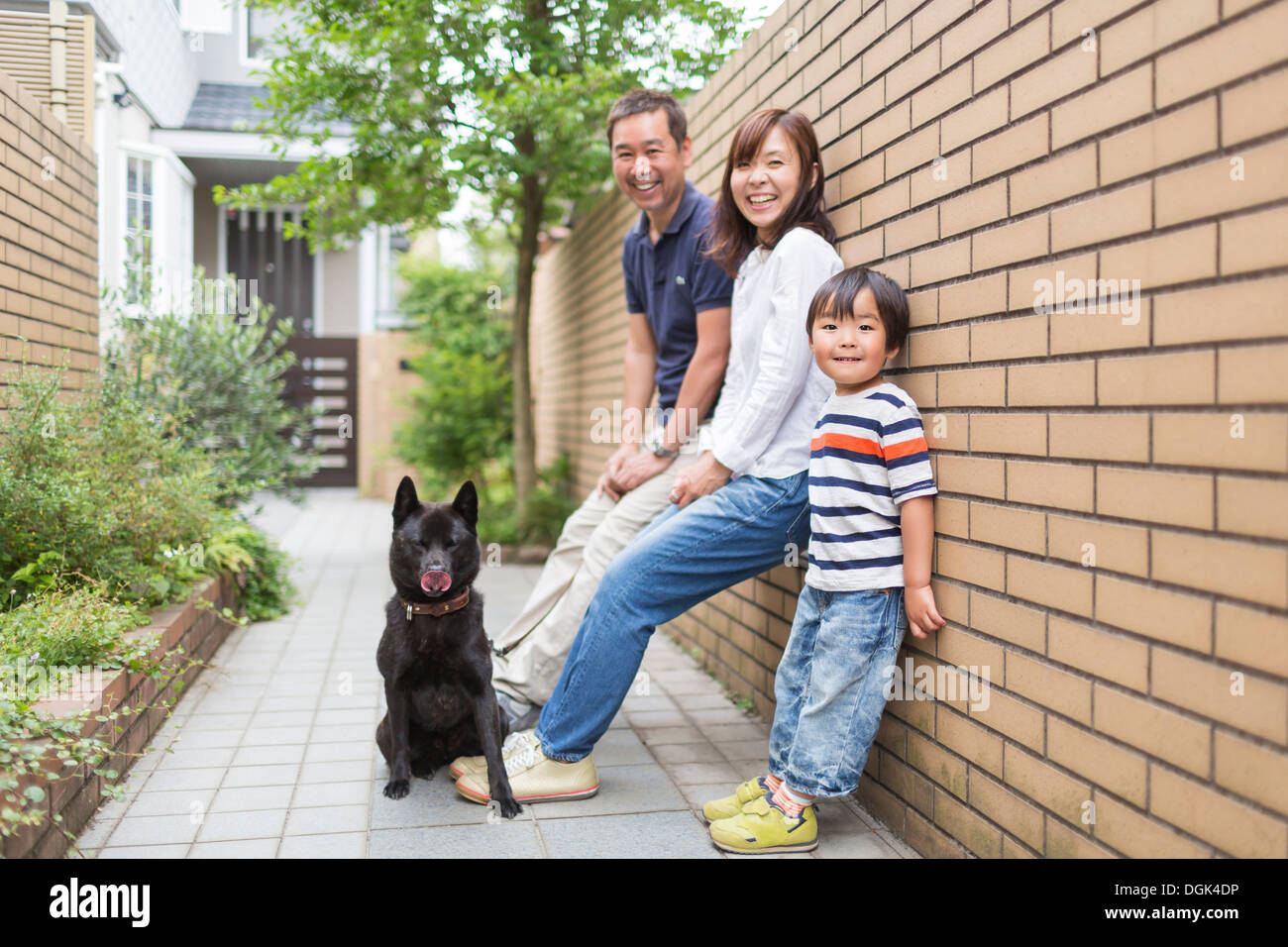 Family outdoors with pet dog - Stock Image