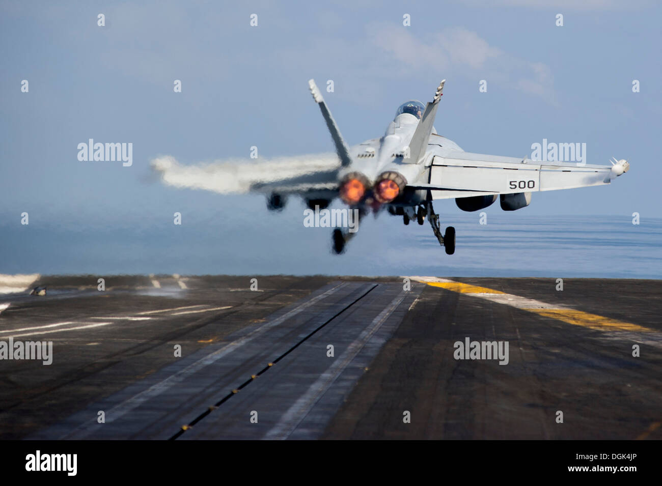 An EA-18G Growler assigned to the Zappers of Electronic Attack Squadron (VAQ) 130 launches from the flight deck of the aircraft - Stock Image