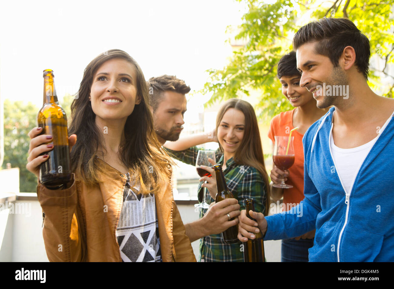 Friends drinking alcohol outdoors - Stock Image