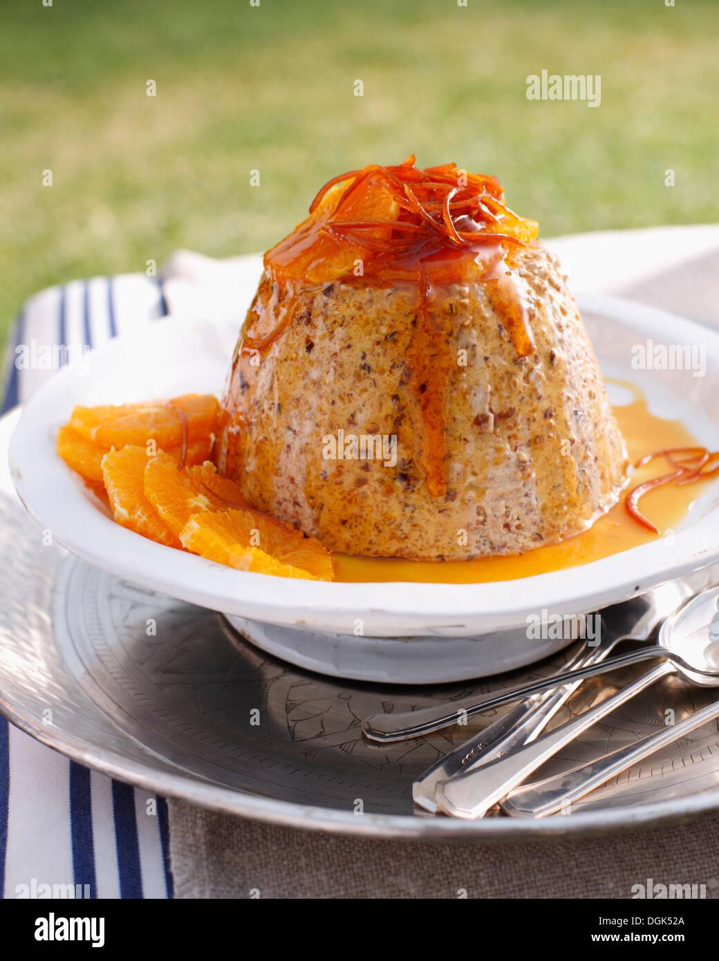 Christmas pudding on garden table in Australian sunlight - Stock Image