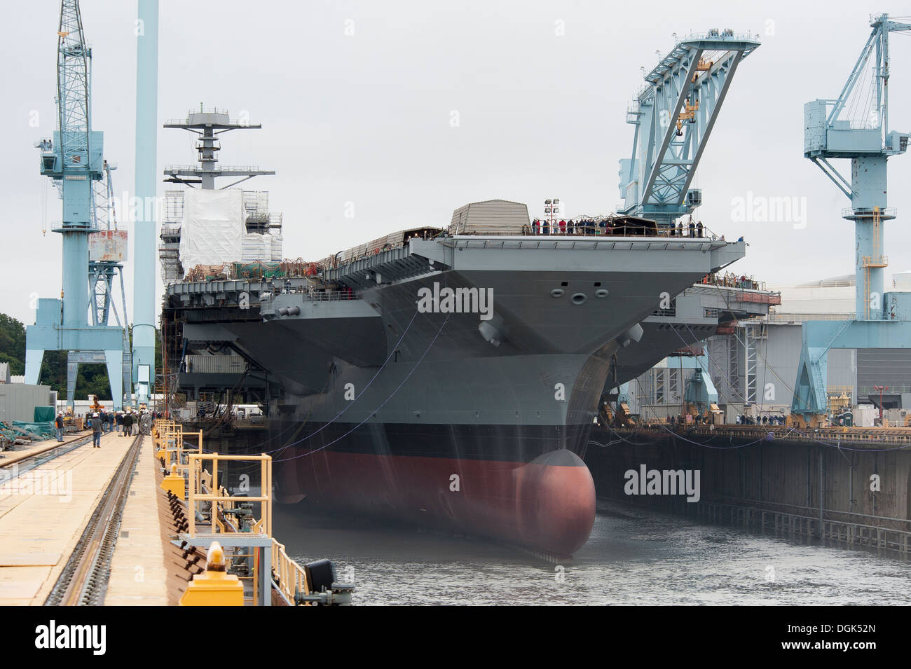 Newport News Shipbuilding floods Dry Dock 12 to float the first in class aircraft carrier, Pre-Commissioning Unit Gerald R. Ford (CVN 78). - Stock Image