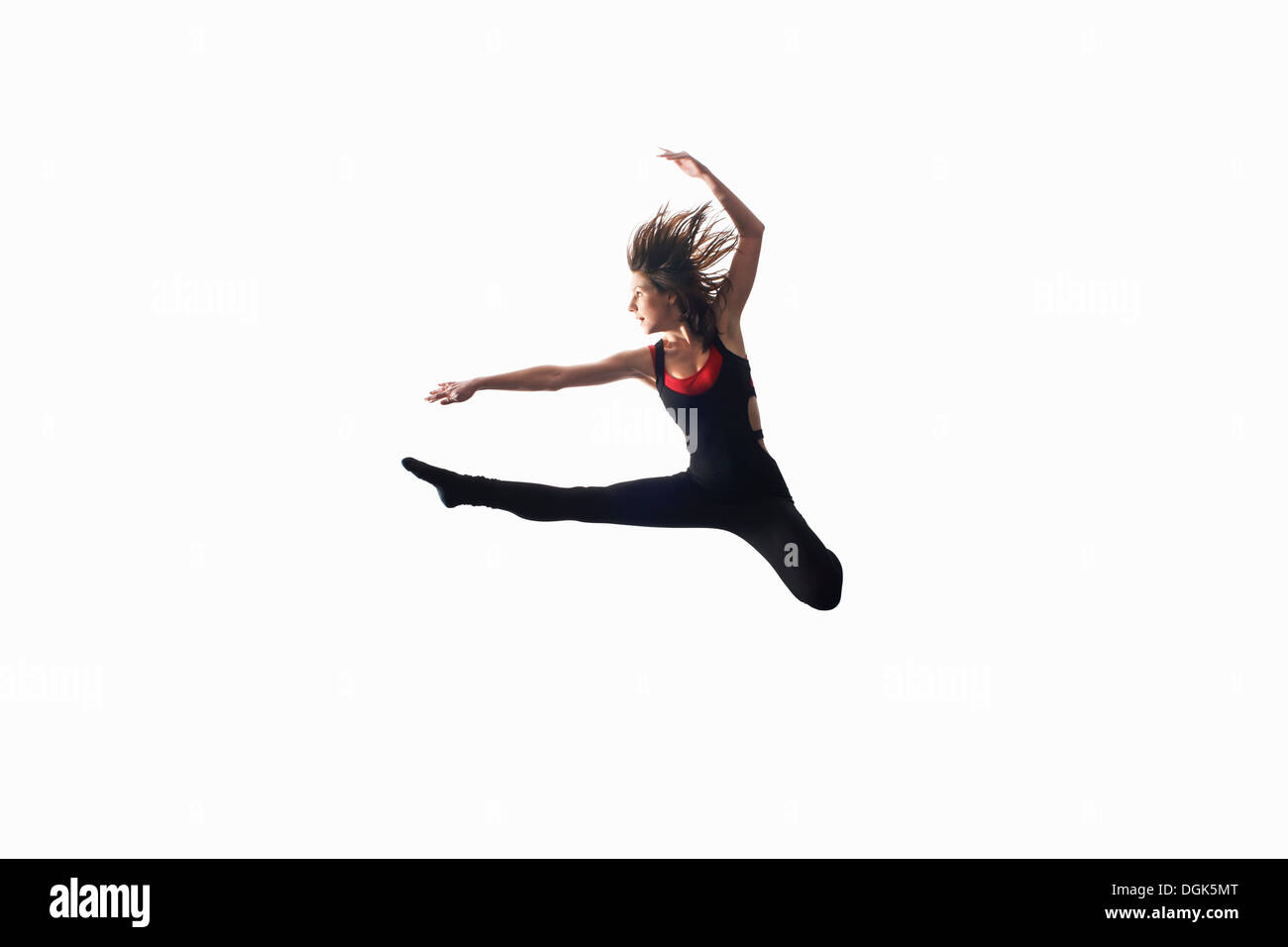 Dancer in midair on white background - Stock Image