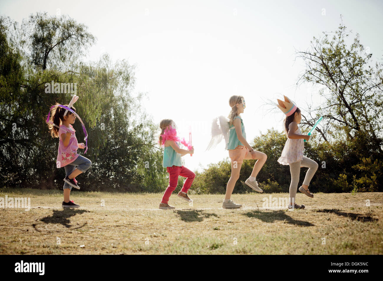 Children in costume marching - Stock Image