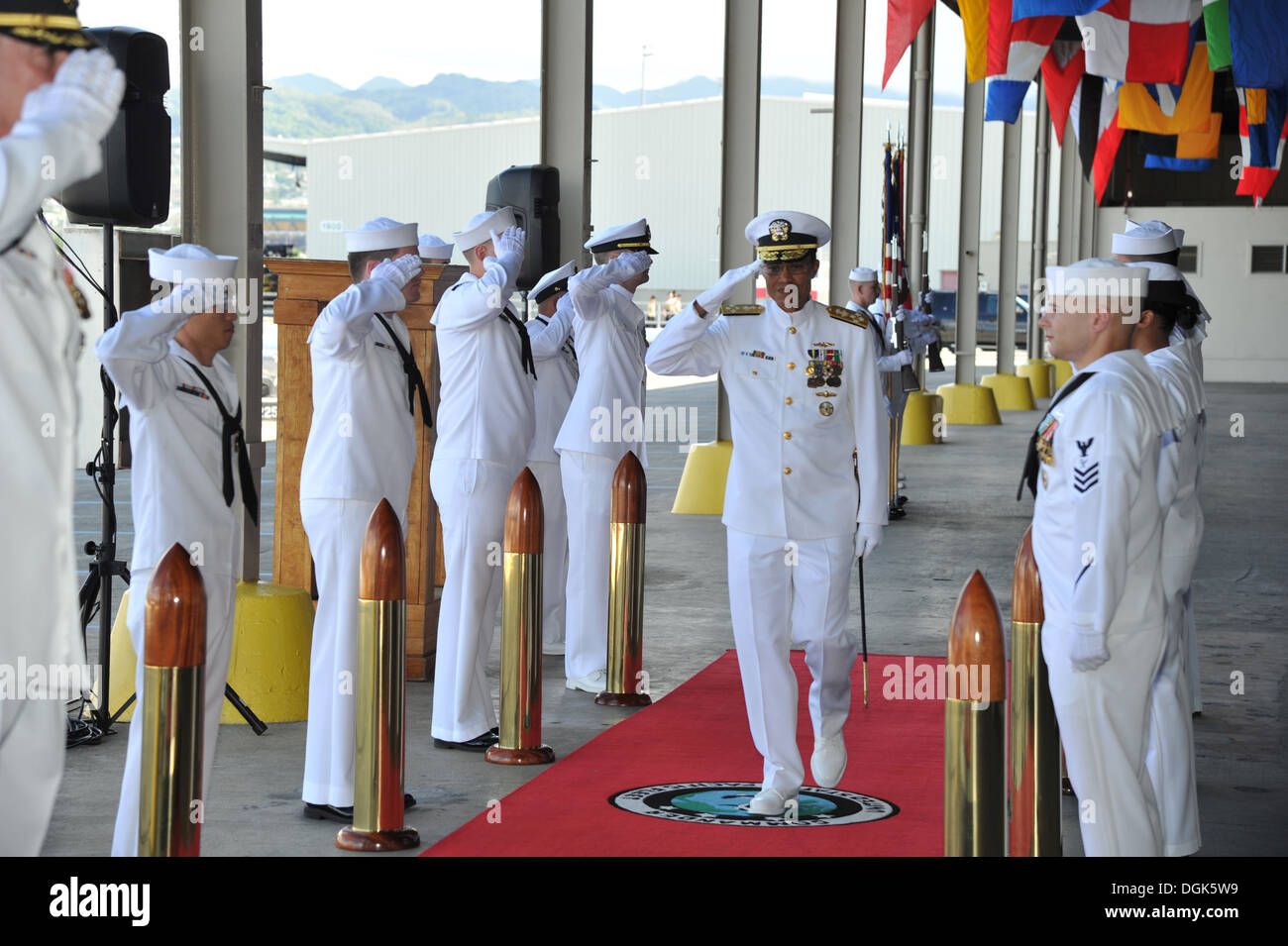 Adm. Cecil D. Haney, commander of U.S. Pacific Fleet, passes through the side boys before being relieved by Adm. Harry B. Harris Jr. during a change of command ceremony on the Pearl Harbor waterfront. During the ceremony, Harris assumed command of the wor - Stock Image
