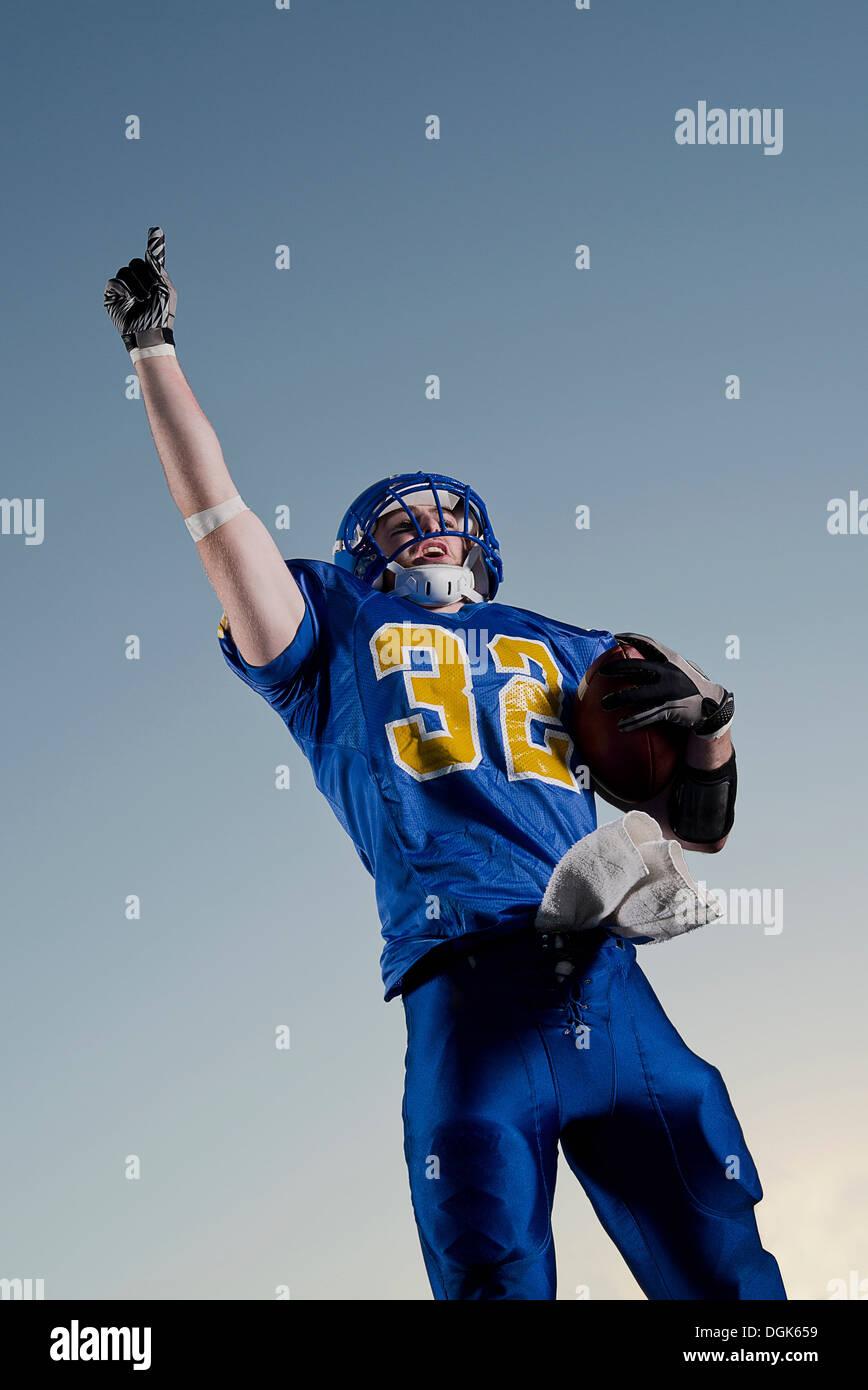 American footballer pointing towards sky - Stock Image
