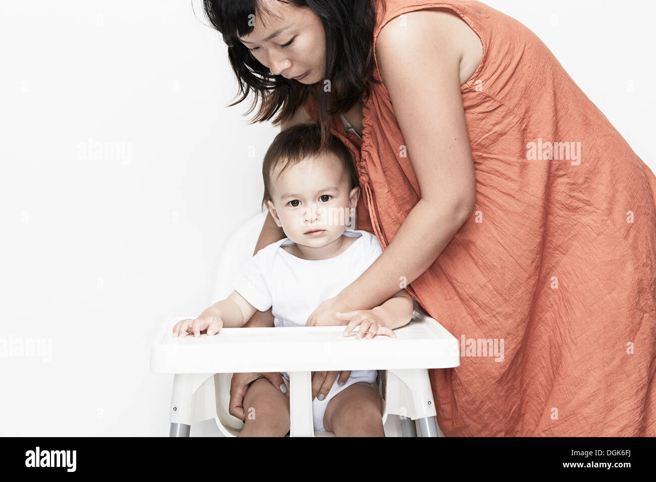 Brilliant Mother Putting Baby Boy Into Highchair Stock Photo 61887830 Short Links Chair Design For Home Short Linksinfo