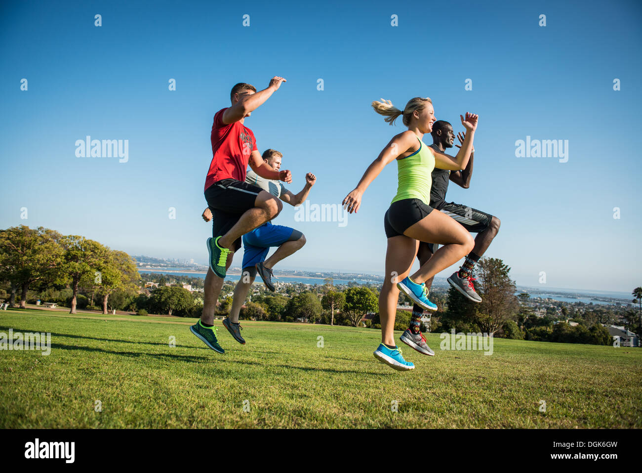 Group of young adults training in field - Stock Image