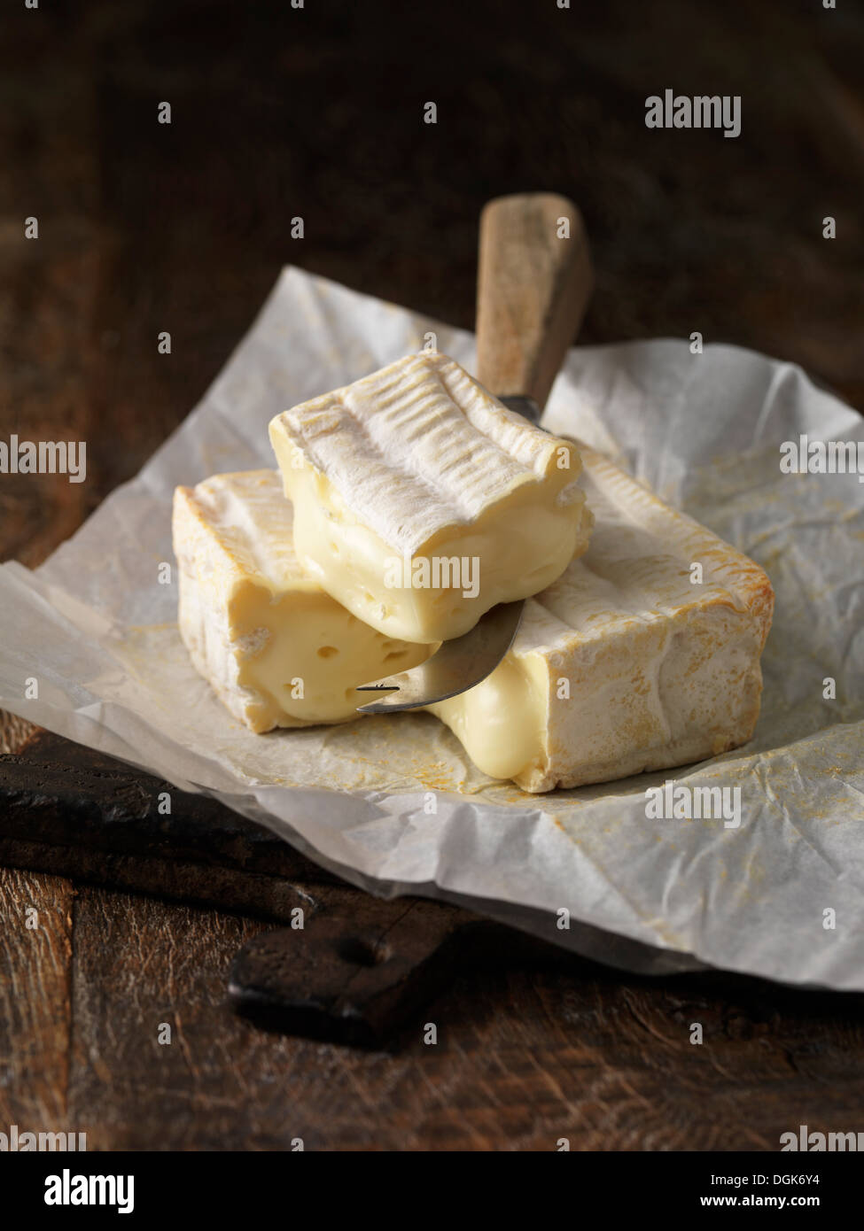 Still life with slice of pont l'eveque cheese - Stock Image