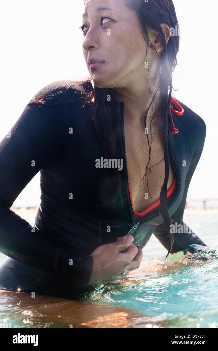 Anxious woman in sea, Hermosa Beach, California, USA - Stock Image