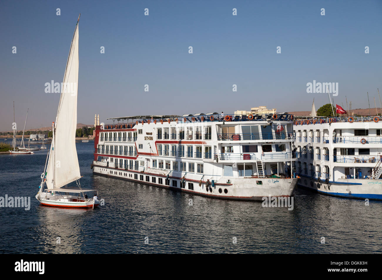 A Felucca and two Nile cruisers at Aswan. - Stock Image