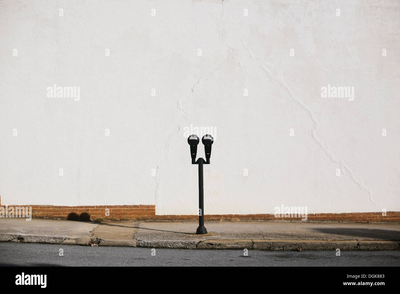 Parking meter on pavement - Stock Image