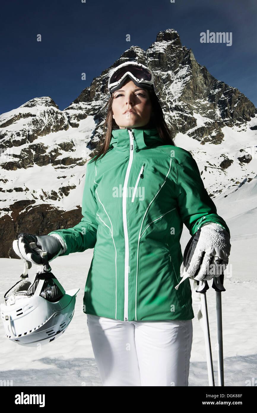 Portrait of female skier on mountain - Stock Image